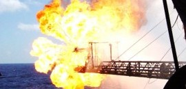 flaring boom, burner showing oil flare during well test operations
